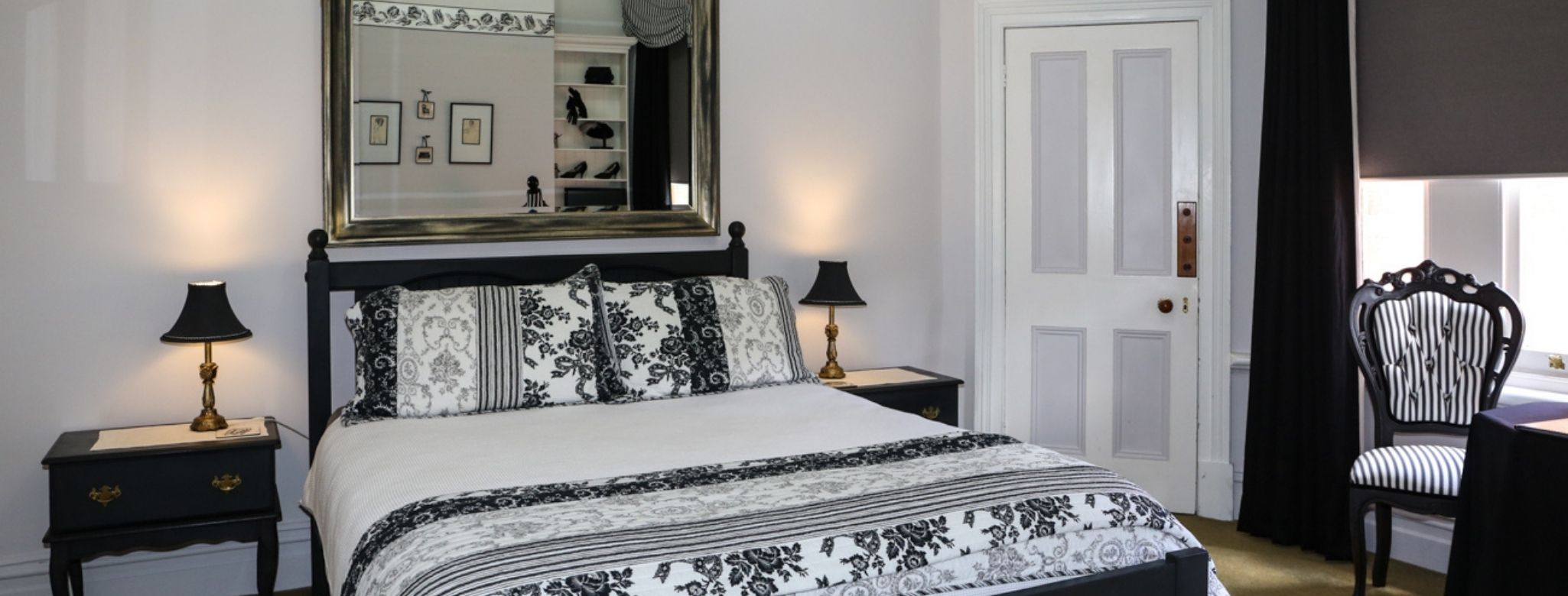 The Huxley Suite At Penghana Bed And Breakfast Accommodation In Queenstown, Tasmania Is Decorated In Stylish Black And White